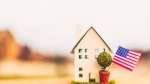 Little house with defocused street. Relocation theme